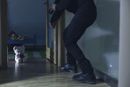 Dangerous adult man breaking into child's bedroom