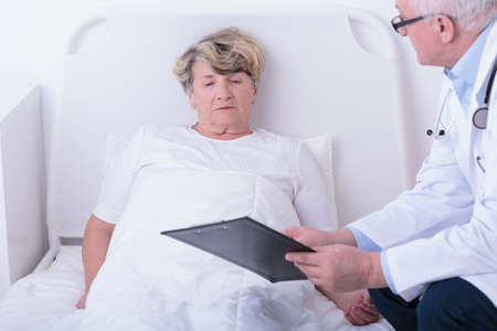 illness: Doctor is showing the test results to his patient