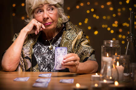 spirit medium: Fortune teller sees a future from cards Stock Photo