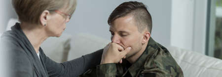 civil disorder: Soldier suffering from postraumatic stress disorder seeing a specialist