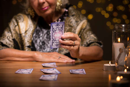 trustful: Fortune teller is putting tarot cards for the client Stock Photo