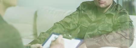 traumatized: Interview with soldier in green military uniform