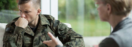 civil disorder: Young traumatized soldier with his psychiatrist