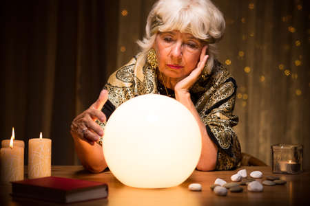 clairvoyant: Sometimes fortune teller does not see anything from crystal ball Stock Photo