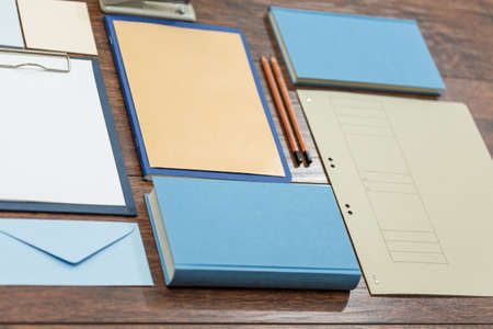 office desk: Colorful notebooks on the wooden office desk Stock Photo