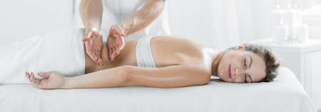 therapeutic: Panorama of content woman during therapeutic body massage