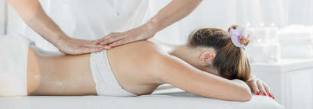 beauty treatment: Panoramic view of woman lying on massage table
