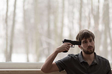 thoughts: Man trying to commit suicide with a gun Stock Photo