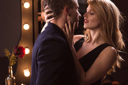 foreplay sex: Young attractive passionate couple wearing elegant clothes