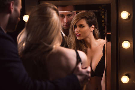 intimate sex: Sexy couple foreplay - reflection in the mirror Stock Photo