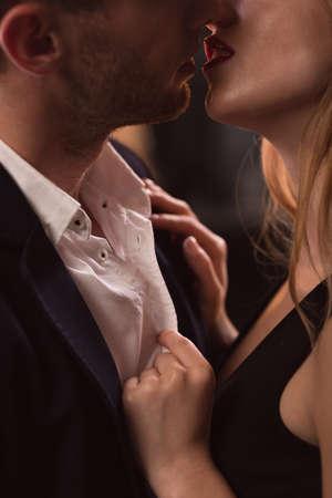 foreplay sex: Close-up of elegant beautiful couple kissing passionately Stock Photo