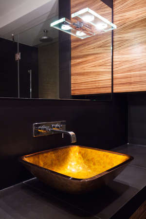 Modern illuminated washbasin in luxury contemporary toilet Archivio Fotografico