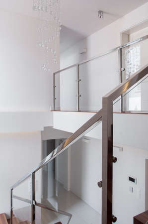 stairs interior: Vertical view of stairs with steel railing
