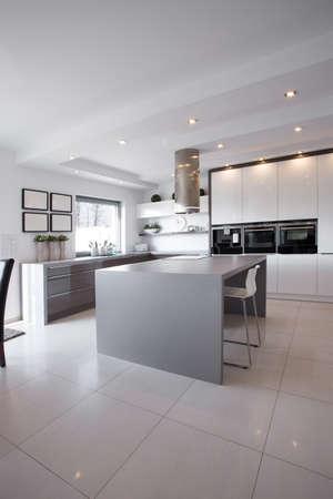 modern: Empty sunny white kitchen in modern apartment