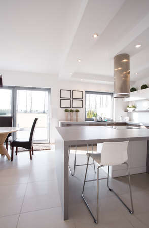 contemporary house: Minimalistic gray table in modern design kitchen