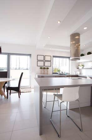 minimalistic: Minimalistic gray table in modern design kitchen