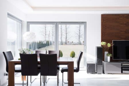 Interior of minimalistic modern bright dining room 스톡 콘텐츠