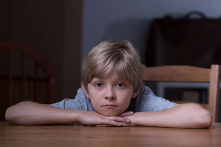 domestic life: Little boy is spending lots of time alone Stock Photo