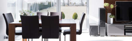 dining table and chairs: Modern wooden table and chairs in stylish dining room