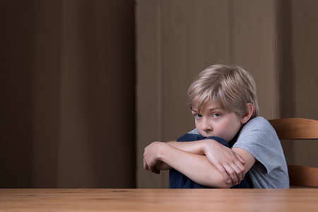 maltreatment: Little boy is scared of his terrible father Stock Photo
