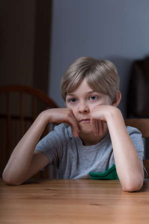 heartbreaking: Little boy is abandoned by his overworked parents Stock Photo