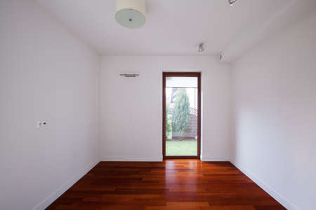 Unfurnished empty room with white walls and wooden floor