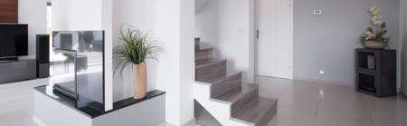 Sunny white hall in minimalistic modern storey house