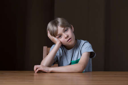 dullness: Young boy is thinking about something