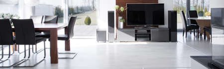 view of an elegant living room: Big screen TV in fashionable modern house