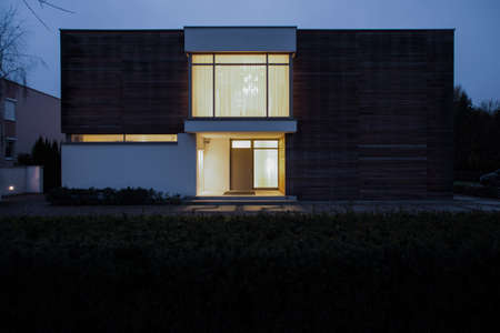 Horizontal view of detached house at night