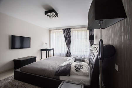 bedroom furniture: View of a fancy bedroom in modern style
