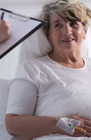 female catheter: Patient is smiling as she discuss her results with doctor