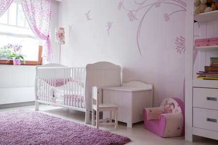 room: Interior of baby room with white furniture and pink details Stock Photo