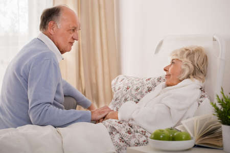 taking a wife: Old man is taking care of his elder wife