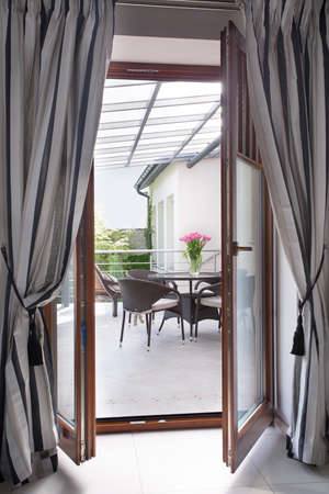 Close up of a balcony door with modern bright curtains