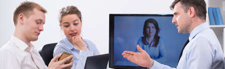 video conference: Impulsive business discussion during video conference with boss
