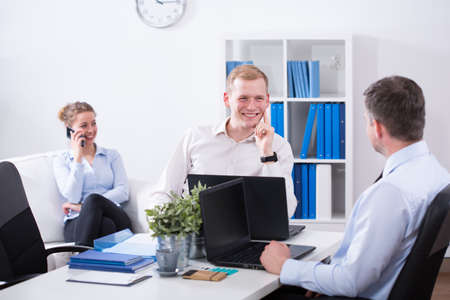 joking: Work colleagues are talking and joking during work