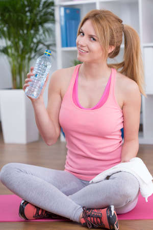 energizing: Drinking water after training is energizing Stock Photo