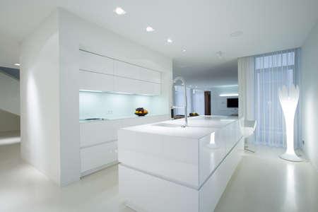 Horizontal view of white gleaming kitchen interior