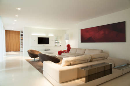 modern painting: Horizontal view of contemporary living room design