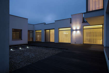 modern apartment: Exterior of single family house at night