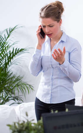 exasperation: Businesswoman is anger and nervous because of talk Stock Photo