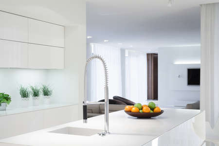 Interior of white kitchen with color details