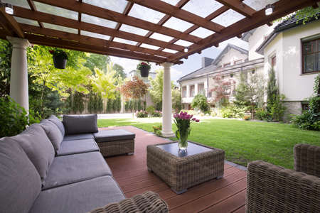outdoors: Photo of luxury garden furniture at the patio Stock Photo