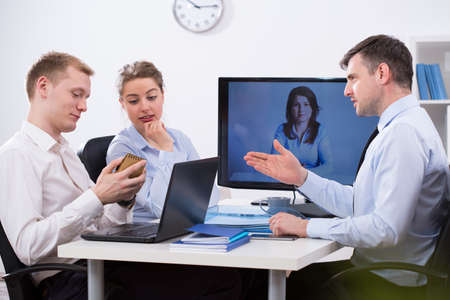 impulsive: Impulsive business discution during video conference with boss