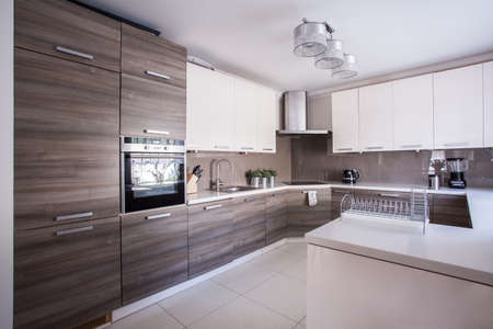 Image of large luxury kitchen furnished in modern design