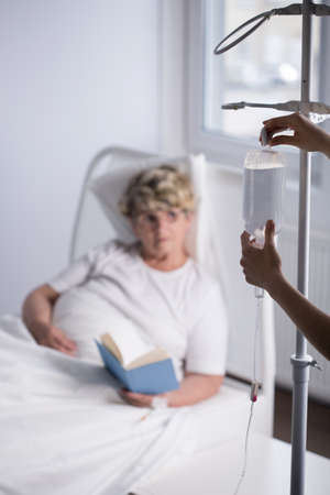 iv bag: Nurse is changing elderly patient iv bag Stock Photo