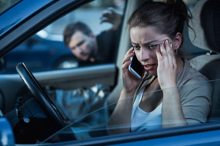 careful: Young woman is not enough careful in the car