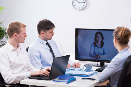 Office employers are talking during video conference