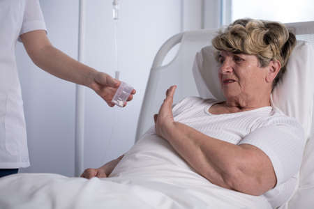 iv bag: Elderly woman is refusing to swallow her prescribed drugs